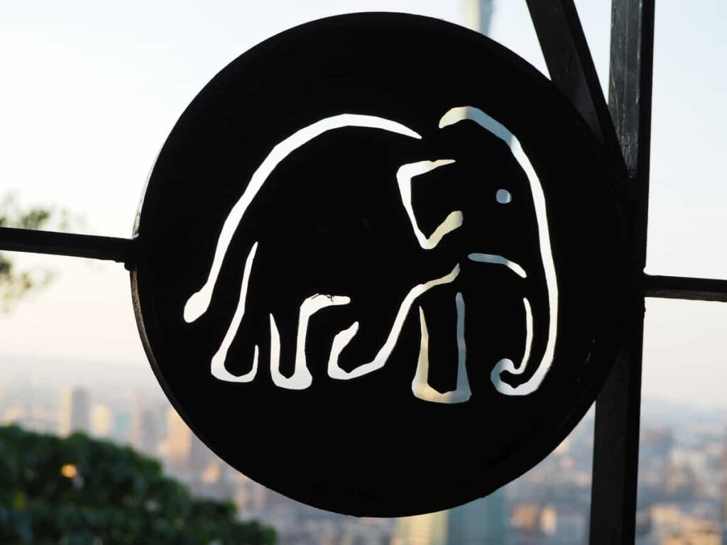 Elephant Mountain sign is a black circle with an elephant outline cut out in the centre.